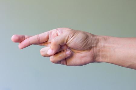 finger crossed: finger crossed hand sign isolated