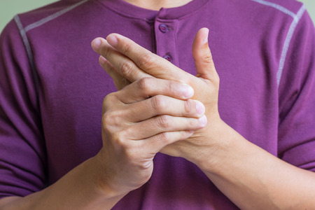 Man with pain in his hand photo