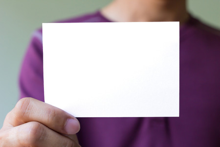 Man hand is holding the blank white card photo