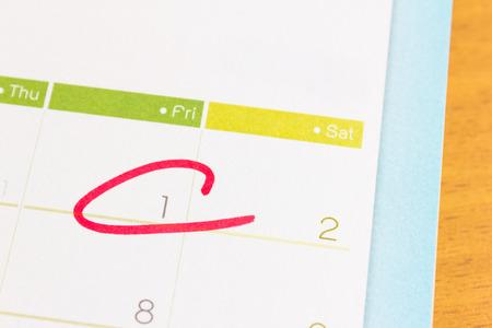 Circle mark on  calendar at 1 photo