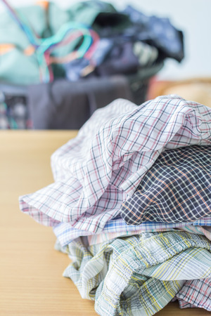 overflows: Pile of dirty cloth. Preparing for wash. Stock Photo