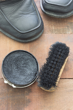 blacking: shoe polish and brush with old Leather shoes Stock Photo