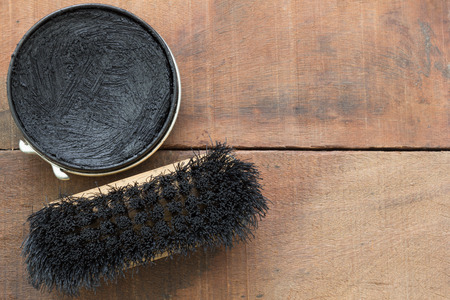 blacking: shoe polish and brush  on wood