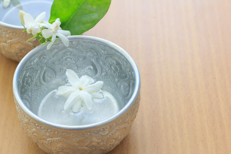 water and jasmine in water dipper Stock Photo