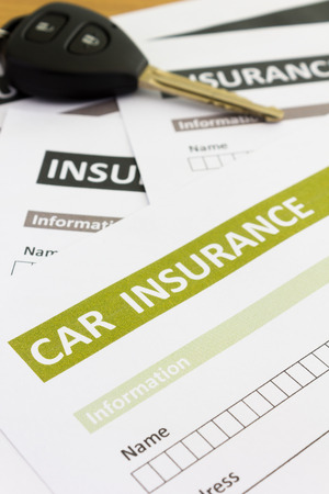 vehicle accessory: Car insurance form with car key Stock Photo