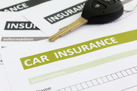 car accessory: Car insurance form with car key Stock Photo