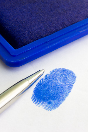 fingerprinted: close up of blue fingerprint