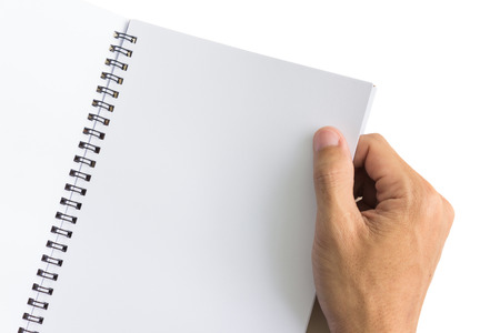 two page spread: Hand opening book on white background