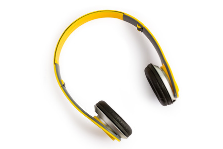 decibels: yellow headphone on white background