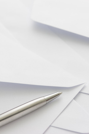 missive: pile of white envelope with pen