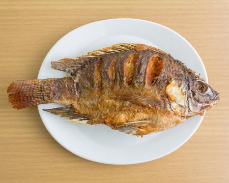 Fried fish on wood table Standard-Bild