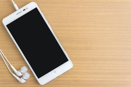 smartphone met oortelefoon en vrije ruimte voor tekst Stockfoto