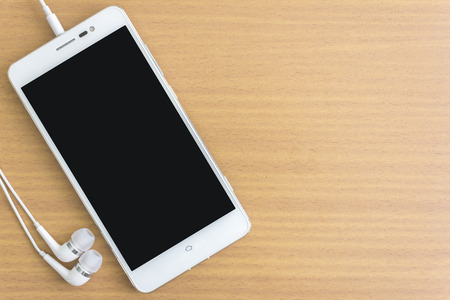 display screen: smartphone with earphone and free space for text Stock Photo