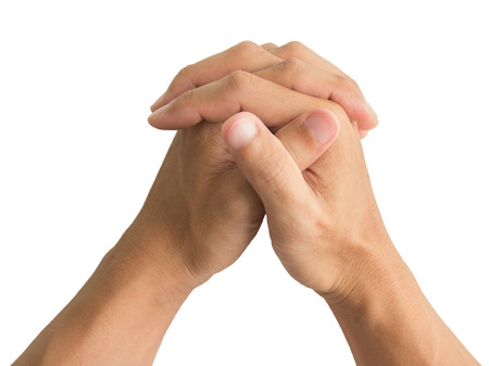 to implore: hands folded praying on white background