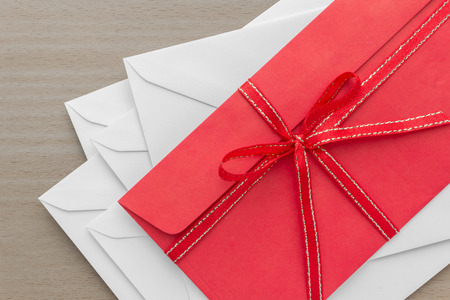envelope decoration: pile of envelopes with red envelope on top