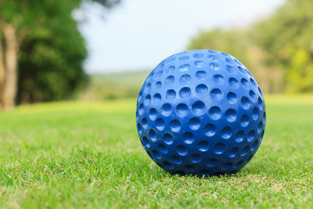 caddie: close up shot of blue golf ball on green Stock Photo