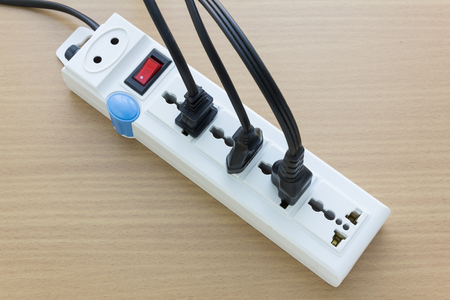 electrical outlet: Multiple electrical plugs on table