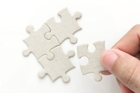 man hand holding last puzzle Stock Photo