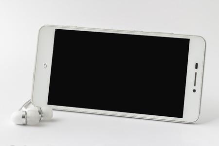 earphone: blank smartphone with earphone