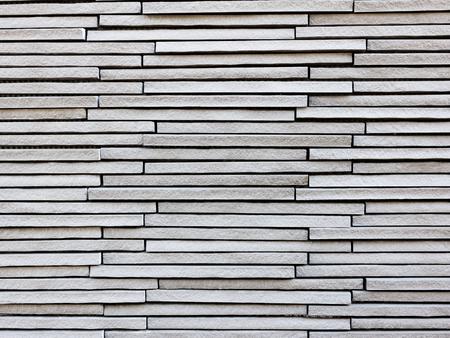gray pattern: gray brick wall pattern background Stock Photo
