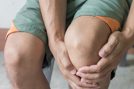 old man on a physical pressure: man with knee pain and feeling bad Stock Photo