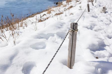 tied: rope tied wood in winter Lizenzfreie Bilder