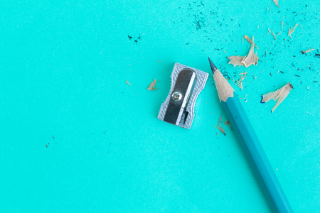 sharpener and pencil on green in top view Standard-Bild - 112688699