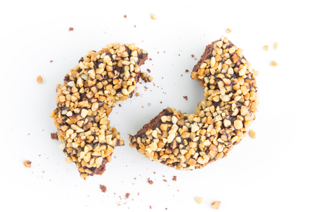 chocolate doughnuts with nuts on white Standard-Bild - 112689393