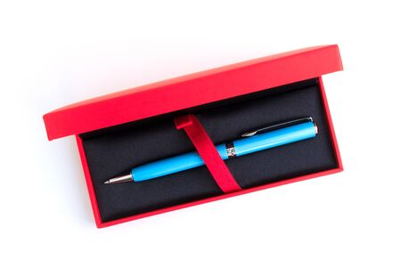 blue pen in red box on white
