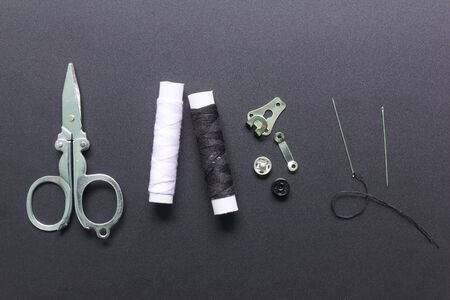 Sewing accessories on black background