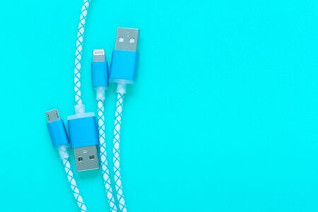 charging cable for smartphone on blue background