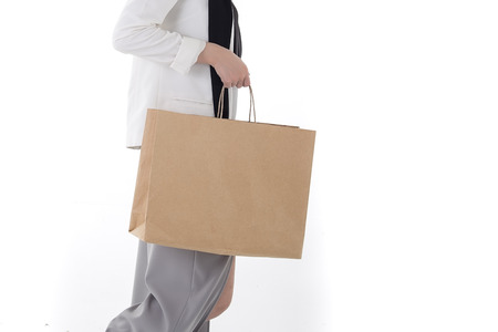 people holding hands: Shopping Bag Stock Photo