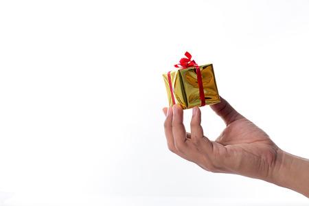 Hand holding  gift box on white background photo