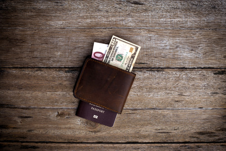 schein: Passport with a note on a wooden table. Stock Photo