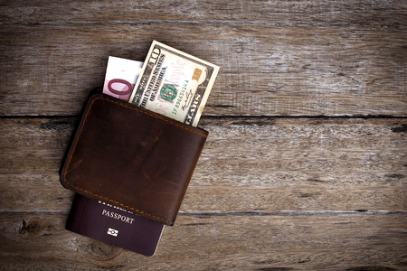 Passport with a note on a wooden table. Stock Photo