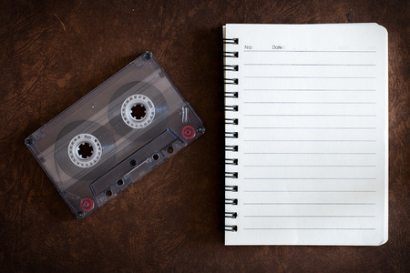 cassette tape: Notebook with music and cassette.