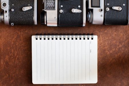 blank notebook with vintage camera. photo