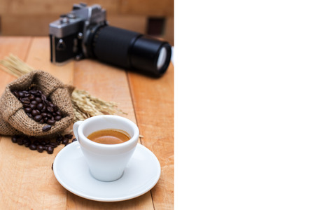 Hot coffee and coffee beans and camera vintage on a wooden table -  menu coffee .