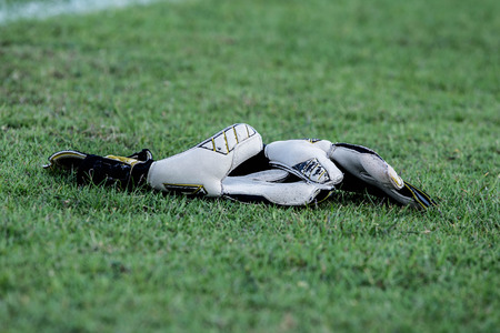 diving save: goalkeeper gloves in the grass on the football field