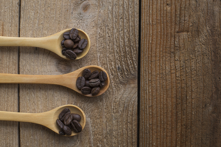 coffee bean Spoon on a wooden table