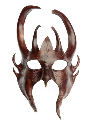 the devils mask of brown leather Stock Photo