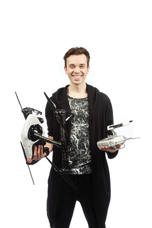 hover: a man stands with a quadrocopter on the white bacground Stock Photo