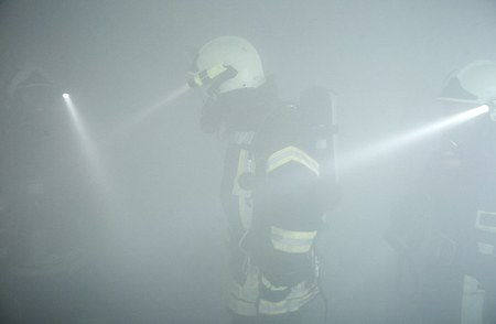 Rescuers have got into the  smoke-filled  room and look for victims at the fire
