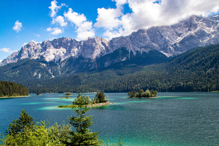 Azure water at Eibsee lake at the foot of Mt. Zugspitze. Location famous resort Garmisch-Partenkirchen, Bavarian alp, Europe. Scenic image of popular travel destination. Discover the worlds beauty.