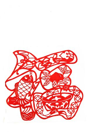 Surplus in quick succession.This is Chinese characters luck ,is a happy and happiness blessing.This is a picture of chinese paper cutting. photo