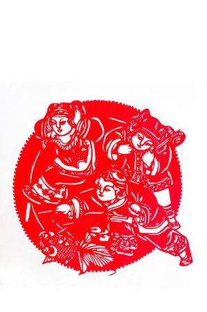 Children are playing .This is a Chinese paper-cut, reflecting the childrens happy life scenes. photo