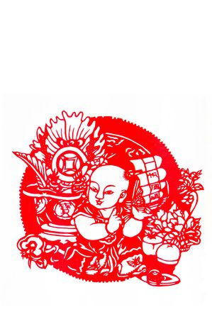 Smooth. This is a Chinese paper-cut, reflecting the childrens happy life scenes. photo