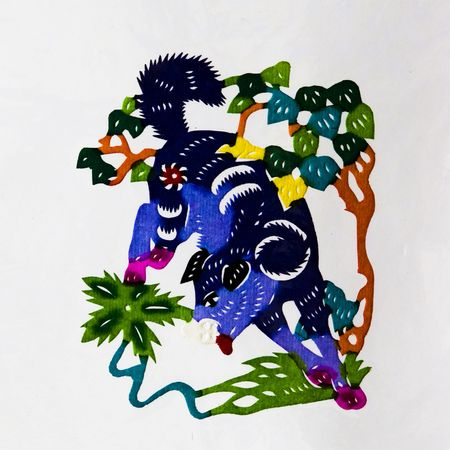 Dog,This is a Chinese paper-cut, reflecting the dog happy life scenarios. photo