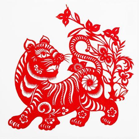 hoofed animal: Tigre, esta muestra de corte en el papel del Tigre, es uno del zodiaco chino. Foto de archivo