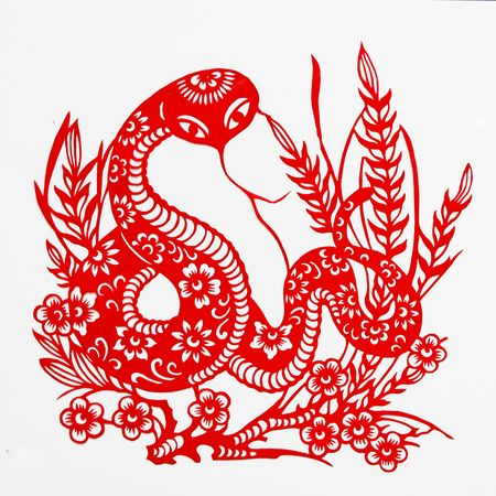 grass snake: snake,This paper-cut shows the snake, is one of the Chinese Zodiac. Stock Photo